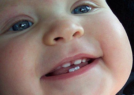 До чого сняться зуби дитини?